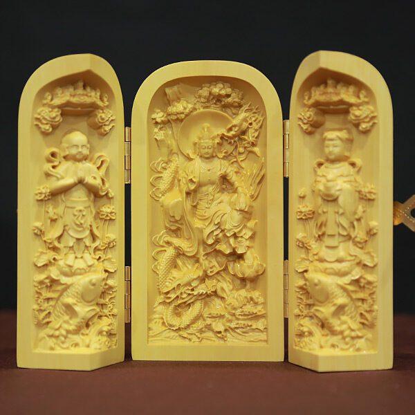 tượng để xe quan âm đồng tử bằng gỗ hoàng dương cao 10cm